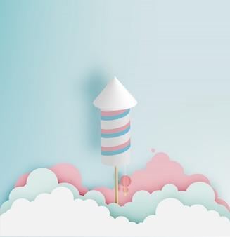 Rakietowy fajerwerk z pastelowym brzmienia tłem w papierowej sztuce
