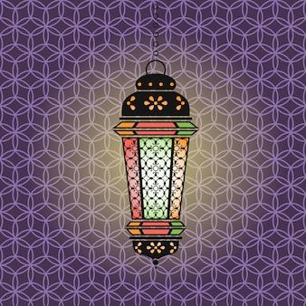 Ramadan ilustracja z wiszącą oświetloną latarnią na kolorowym tle arabskiego wzoru
