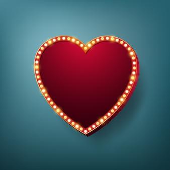Ramka światła w kształcie serca z żarówkami elektrycznymi.