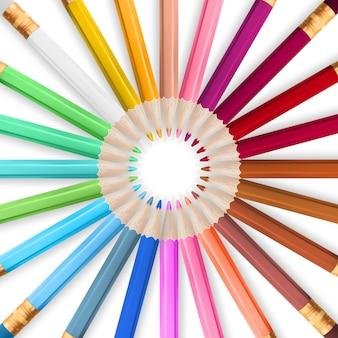 Ramka z kolorowymi kredkami.