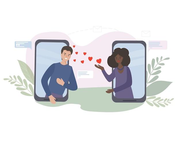 Randki i komunikacja online. wirtualna romantyczna randka. miłość podczas kwarantanny. spotkanie kochanków na czacie wideo za pośrednictwem aplikacji na smartfona w sieciach społecznościowych. amerykańska czarna kobieta i biały człowiek.