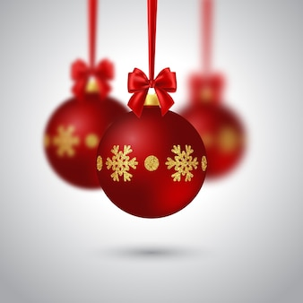 Realistyczna bombka bożonarodzeniowa z czerwoną kokardą. efekt rozmycia. elementy dekoracyjne na boże narodzenie wakacje tło. ilustracja wektorowa.