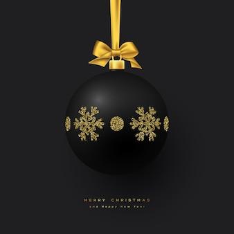 Realistyczna bożonarodzeniowa czarna bombka ze złotą kokardką. element dekoracyjny na boże narodzenie wakacje tło. ilustracja wektorowa.