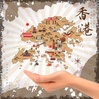 Realistyczna dłoń trzymająca mapę podróży hongkongu - podróż hongkongu w chińskim słowie w prawym górnym rogu