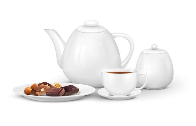 Realistyczna kompozycja kawy herbacianej z widokiem z przodu zestawu z filiżankami do czajnika i czekoladą na talerzu