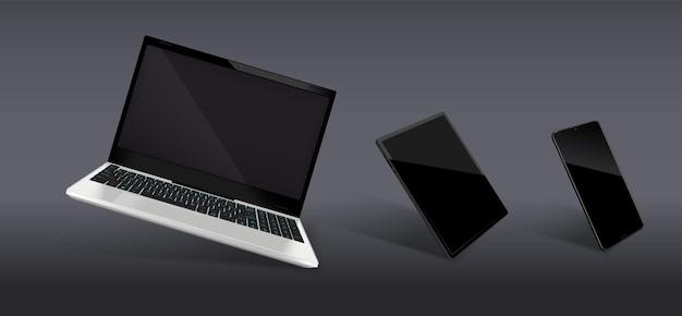 Realistyczna kompozycja składa się z nowoczesnych modeli laptopa i smartfona z czarnymi błyszczącymi ekranami
