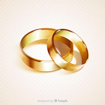 Realistyczna para złotych obrączek ślubnych