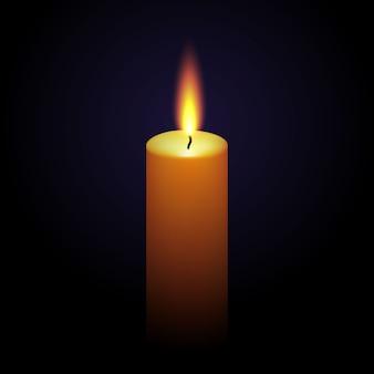 Realistyczna parafinowa płonąca świeczka odizolowywająca na czerni