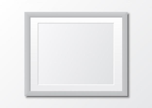Realistyczna szara pusta ramka z cieniem. ramka na zdjęcia na białym tle