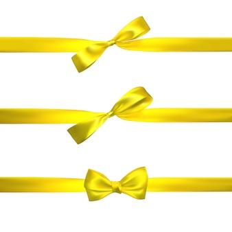 Realistyczna żółta kokarda z poziomymi żółtymi wstążkami na białym tle. element do dekoracji, prezenty, pozdrowienia, święta.