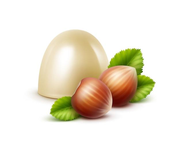 Realistyczne białe cukierki czekoladowe mleczne z orzechami laskowymi na białym tle
