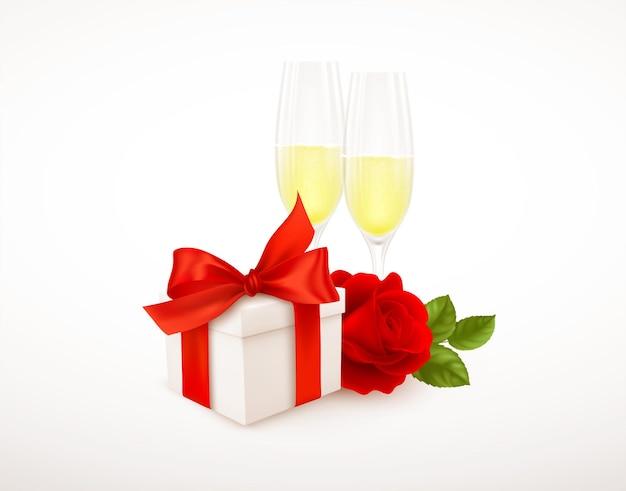 Realistyczne białe pudełko z czerwoną wstążką, dwie szklanki szampana i czerwona róża na białym tle.
