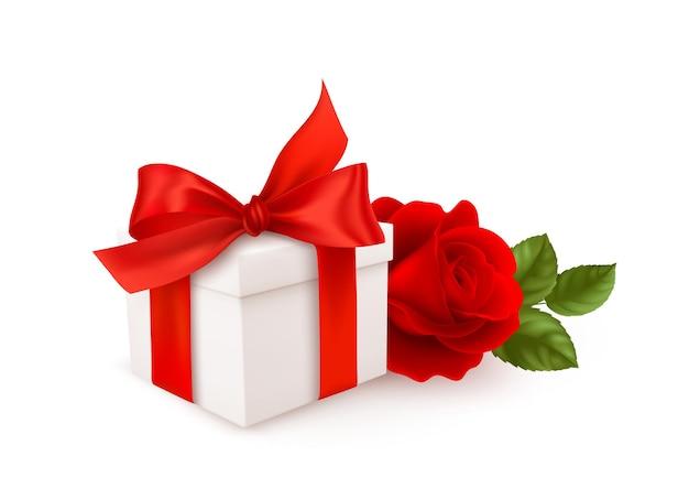 Realistyczne białe pudełko z czerwoną wstążką i czerwoną różą na białym tle