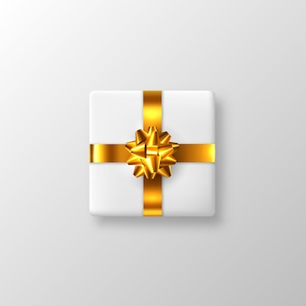 Realistyczne białe pudełko ze złotą kokardką i wstążką. ilustracja.