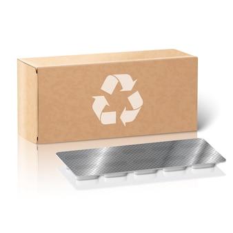 Realistyczne białe puste pudełko na leki z papieru rzemieślniczego z pigułkami w foliowym blistrze