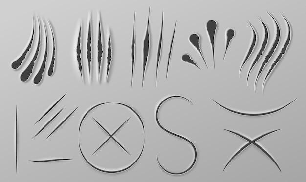 Realistyczne cięcia nożem do papieru. zadrapania pazurami dzikich zwierząt, linia cięcia i ostre krzyżowe rany ostrza. zestaw wektorów łap i ataków bestii