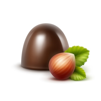 Realistyczne ciemne cukierki czekoladowe z pełnym nieobranym orzechem laskowym z liśćmi z bliska na białym tle na białym tle