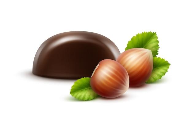 Realistyczne ciemne czarne gorzkie cukierki czekoladowe z orzechami laskowymi z bliska na białym tle