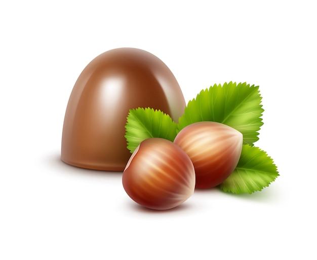 Realistyczne cukierki czekoladowe mleczne z orzechami laskowymi na białym tle