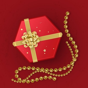 Realistyczne czerwone pudełko upominkowe ozdobione złotą kokardką, widok z góry.