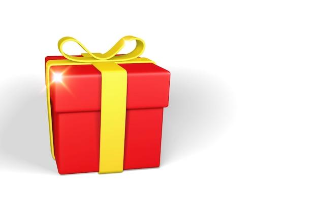 Realistyczne czerwone pudełko z żółtą kokardką i wstążką na białym tle
