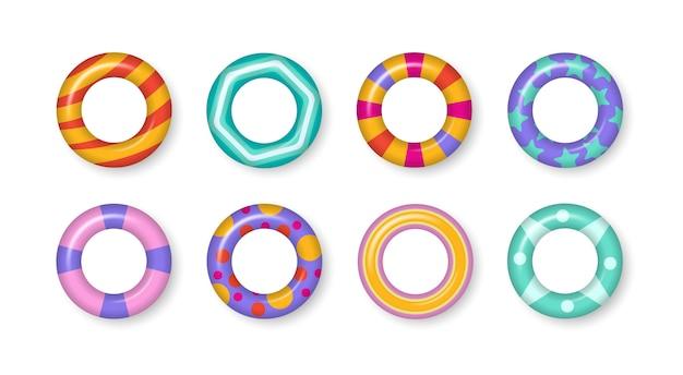 Realistyczne gumowe pływanie 3d pierścienie na przezroczystym tle. zestaw kolorowych pierścieni pływackich. motyw lato, woda i plaża, bezpieczne ikony. letnie wakacje lub bezpieczeństwo podróży. ilustracja.