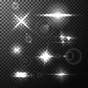 Realistyczne jasne flary obiektywu emitują promienie i błyski na przezroczystym tle