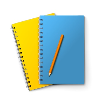 Realistyczne niebieskie i żółte notatniki i ołówek wyizolowanych na białym tle ilustracji wektorowych