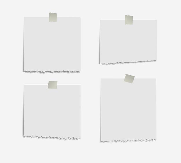 Realistyczne podarte karteczki na białym tle z prawdziwym cieniem