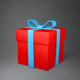 Realistyczne pudełko z czerwoną kokardą na białym tle