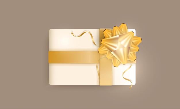 Realistyczne pudełko ze złotymi wstążkami i kokardką.