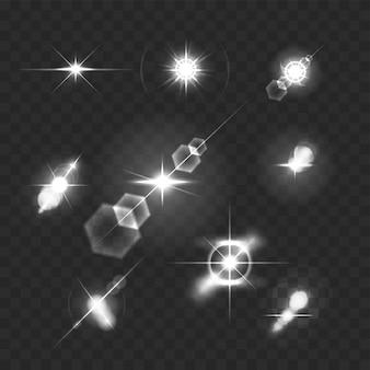 Realistyczne rozbłyski obiektywu światła gwiazd i świecące białe elementy na przezroczystej ilustracji