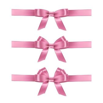 Realistyczne różowe wstążki i kokardki na białym tle.
