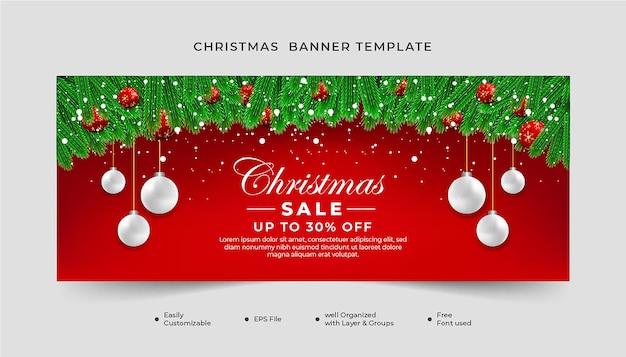 Realistyczne świąteczne wyprzedaż transparent zielony liść z boże narodzenie elementem czerwonym tle.