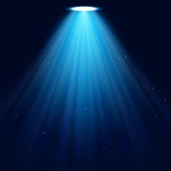 Realistyczne świecące reflektory na ciemnoniebieskim tle. ilustracja wektorowa tła.