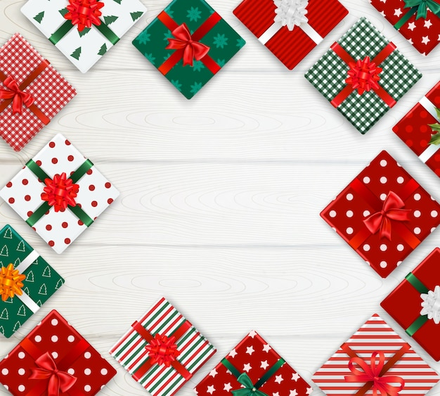 Realistyczne tło z zdobione świąteczne pudełka wzór na białym drewnianym stole