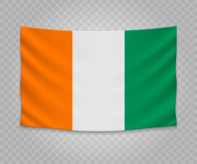 Realistyczne wiszące flagi wybrzeża kości słoniowej