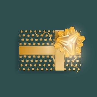 Realistyczne zielone pudełko prezentowe ze złotymi gwiazdami, złotymi wstążkami i kokardką. widok z góry.
