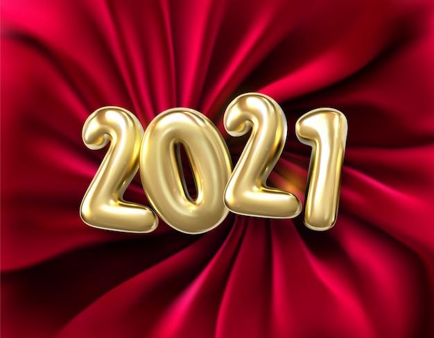 Realistyczne złote cyfry 2021 i czerwony jedwabny materiał, czerwone tło tkaniny.