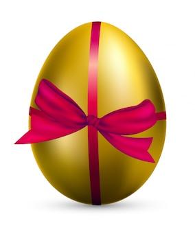 Realistyczne złote jajko w czerwonej wstążce prezent