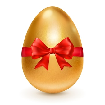 Realistyczne złote jajko wielkanocne przewiązane czerwoną wstążką z dużą czerwoną kokardą