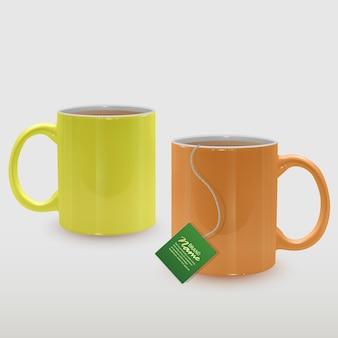Realistyczne żółte i pomarańczowe filiżanki do herbaty, kubki do herbaty