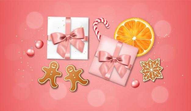 Realistyczny prezent z kokardą i piłką na białym tle, różowe tło, elementy ciasta, ciasteczka, cukierki świąteczne i pomarańczowe, wesołych świąt, uroczystości