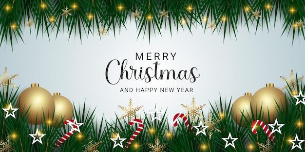 Realistyczny świąteczny sztandar z zielonym liściem złote płatki śniegu złote kulki i bożonarodzeniowe światła cukierki