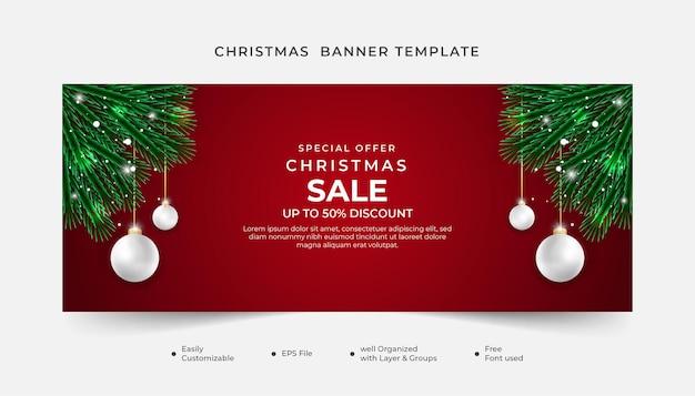 Realistyczny szablon transparentu świątecznej sprzedaży z zielonym liściem i czerwonym tłem