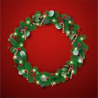 Realistyczny wieniec świąteczny z cukierkami