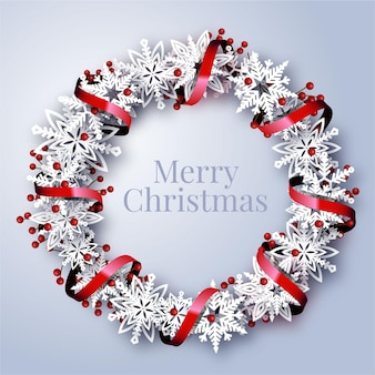 Realistyczny wieniec świąteczny z płatkami śniegu