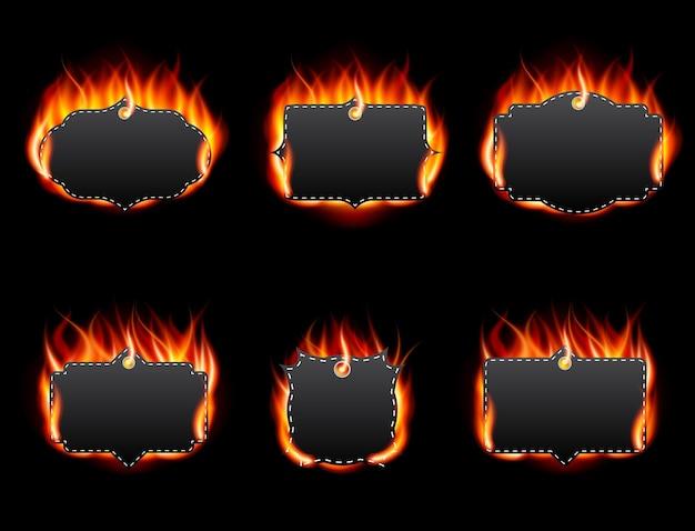 Realistyczny zestaw etykiet ognia na ciemnym tle