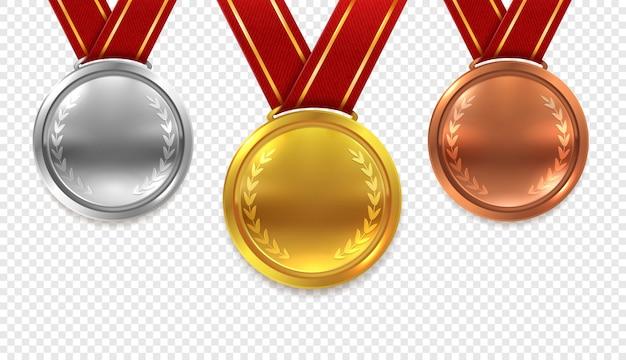 Realistyczny zestaw medali. złote brązowe i srebrne medale z czerwonymi wstążkami na przezroczystym tle kolekcji