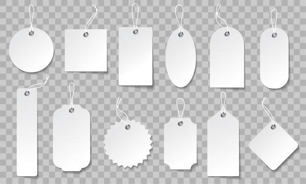 Realistyczny zestaw metek. etykiety z białego papieru w różnych kształtach.